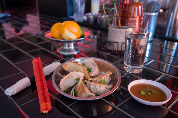 Open since November, Dumpling, a restaurant at 4004 Minnehaha offers asian fusion, including this pork dumplings and dipping sauce along with beer, wine and sake cocktails, Friday, December 15, 2017. (Special to the Pioneer Press: Craig Lassig)