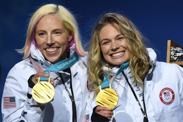 PYEONGCHANG-GUN, SOUTH KOREA - FEBRUARY 22: Gold medalists Kikkan Randall and Jessica Diggins of the United States celebrate during the medal ceremony for Cross-Country Skiing - Ladies' Team Sprint Free on day 13 of the PyeongChang 2018 Winter Olympic Games at Medal Plaza on February 22, 2018 in Pyeongchang-gun, South Korea. (Photo by David Ramos/Getty Images)