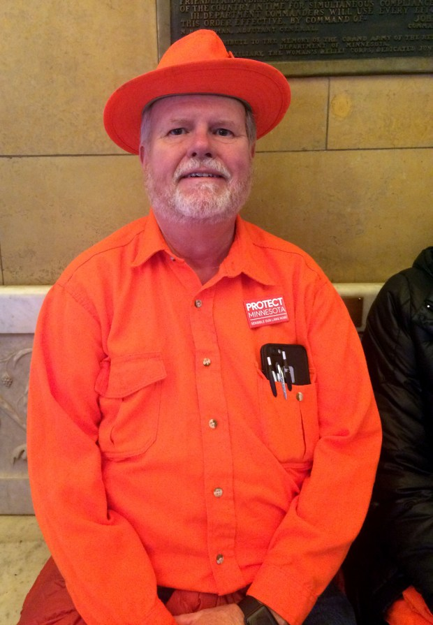 Clad in his blaze orange hunting clothes, Dana Dickson of Brooklyn Park, Minn., sits during a gun control rally Thursday, Feb. 22, 2018, in the State Capitol rotunda in St. Paul. A traditional safety color of hunters, blaze orange is also the adopted color of many gun control advocates. Dickson is both. (Dave Orrick / Pioneer Press)