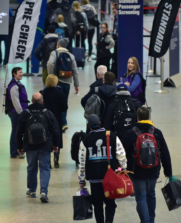 There was plenty of help on hand to direct travelers at Minneapolis/St. Paul International Airport on Monday. The airport was set to handle over 50,000 passengers on Monday, Feb, 5, 2018, mostly from people departing the Twin Cities after Super Bowl LII. (John Autey / Pioneer Press)