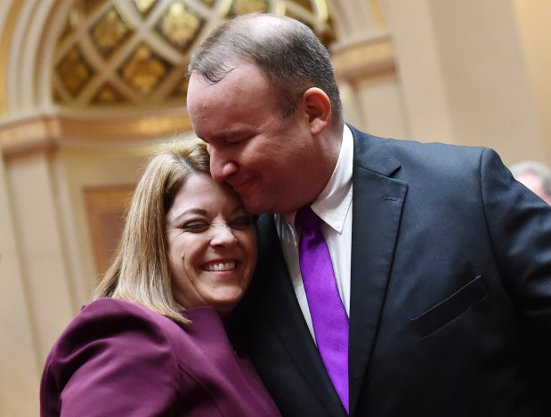 State Senator Karla Bigham, DFL-Cottage Grove, gets a big hug from her husband, John Stechmann, after being sworn in on the opening day of the 2018 Minnesota Legislature at the State Capitol in St. Paul on Tuesday, Feb. 20, 2018. (John Autey / Pioneer Press)
