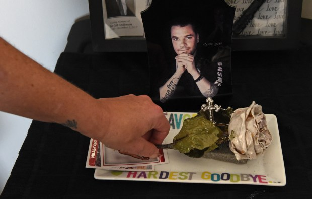 In a corner of her bedroom, Anne Emerson keeps a photo of her fiancee, Ryan, who died from a heroin overdose, along with a white rose from his casket in Ramsey, Thursday, Feb. 8, 2018. Ryan struggled for years with his addiction, but continued to relapse. (Jean Pieri / Pioneer Press)