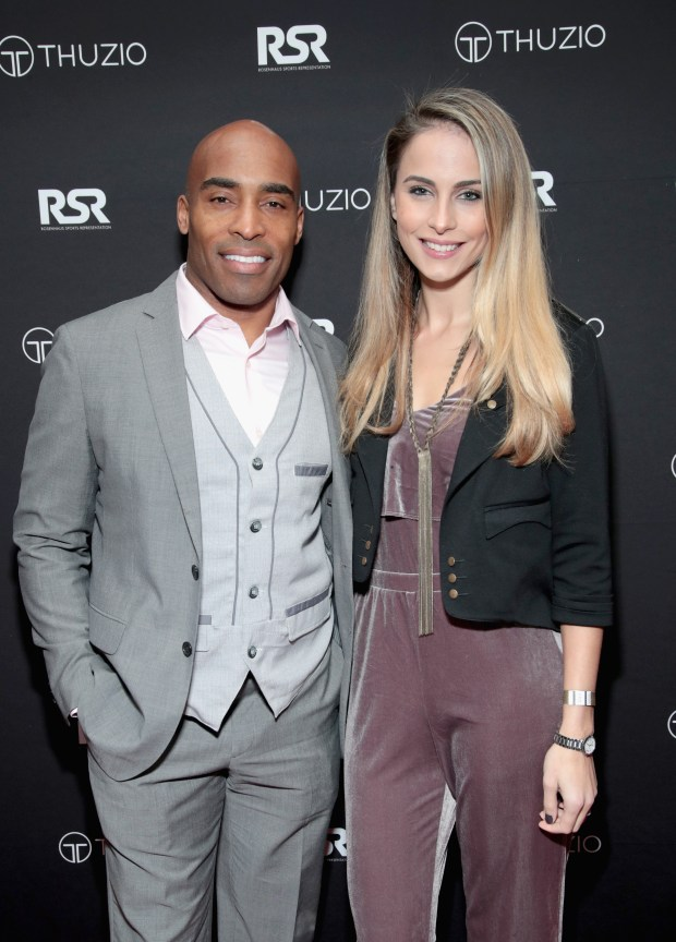 Tiki Barber and Traci Lynn Johnson arrive at the Thuzio & Rosenhaus Party during Super Bowl weekend at The Exchange & Alibi Lounge on Friday, Feb. 2, 2018, in Minneapolis. (Photo by Cindy Ord/Getty Images for Thuzio)
