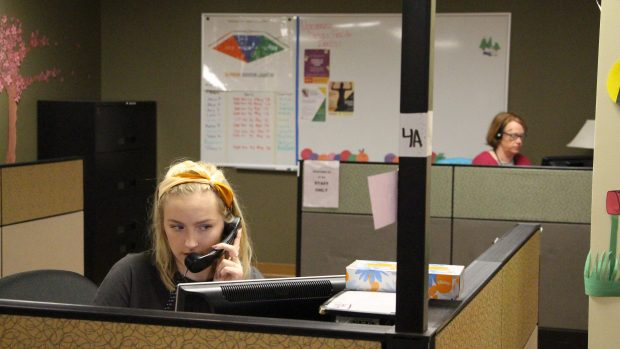 Crisis Line Counselor Shea, 22, takes a call Monday, March 26. (Callie Schmidt / Pioneer Press)