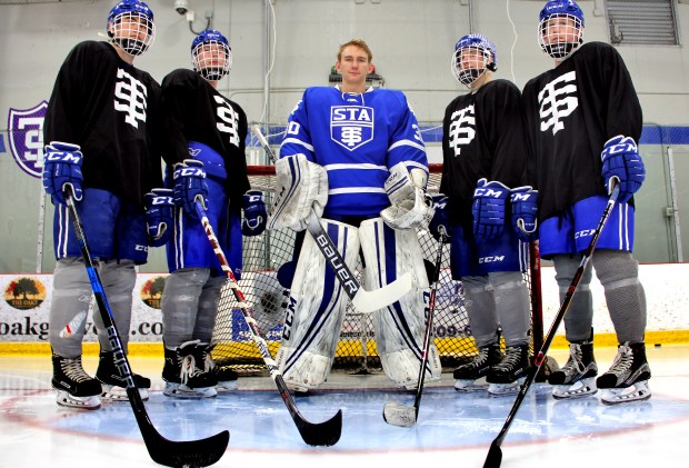 St. Thomas Academy Cadets senior goaltender Atticus Kelly, center, photographed at the St. Thomas Ice Arenal in Mendota Height on on Monday, March 5, 2018, is the 2017-18 Pioneer Press boys hockey Player of the Year. Kelly's teammates are, from left, Carter Henry, Blake Holmes, Chase Foley and Andrew Boemer. (Jace Frederick / Pioneer Press)