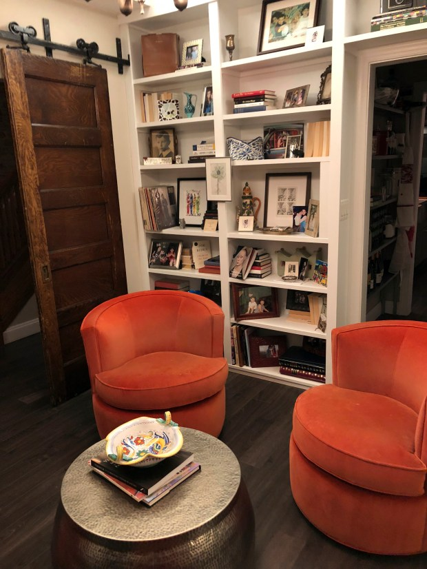 This undated photo shows Cari Shane's renovated row house in Washington D.C. Shane took her college-aged daughter's advice and used backwards facing books to decorate a living space. (Sam Parven via AP)