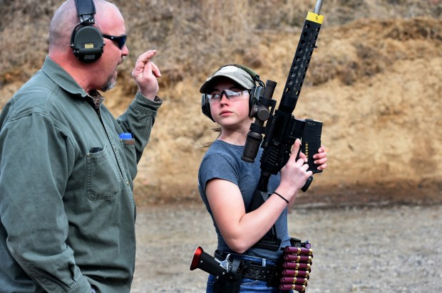 Dakota Overland, 14, a competitive shooter who travels to meets across the nation, with her dad, Todd, at a gun range in Forest Lake on Friday, March 23, 2018. (Jean Pieri / Pioneer Press)