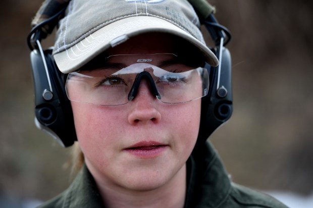 Dakota Overland, 14, a competitive shooter who travels to meets across the nation, with her dad, Todd, at a gun range in Forest Lake on Friday, March 23, 2018. She speaks at the NRA and Second Amendment rallies. (Jean Pieri / Pioneer Press)