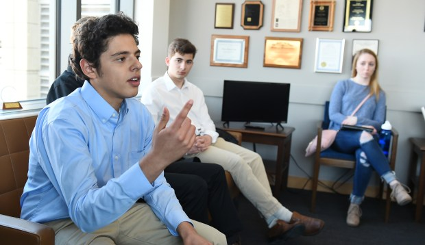 Adrian Ali-Caccamo, a junior from St. Paul's Central High, talks with Sen. Richard Cohen, DFL-St. Paul, at the Minnesota Senate Office Building in St. Paul as he and a group of Minnesota high school students lobbying for stricter gun control laws met with legislators on Wednesday, March 14, 2018. (John Autey / Pioneer Press)