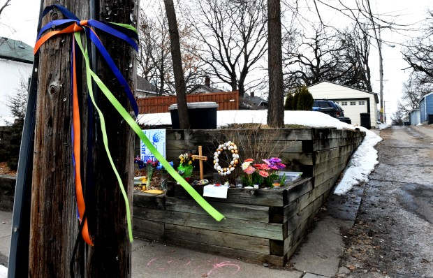 Flowers, candles and messages are close to an alley west of Washburn Avenue South on 51st Street in Minneapolis, Wednesday, March 21, 2018. A Minneapolis police officer, Mohamed Noor, shot and killed Justine Damond after she called 911 to report an assault July of 2017. (Jean Pieri / Pioneer Press)