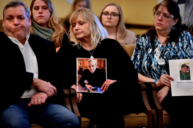 "Listening to speakers during an Opoid Awareness Day rally at the State Capitol in St. Paul on Thursday, March 1, 2018, are Dan and Carol Hagebak, left, whose son David died of an opiate overdose Feb. 18, 2016, after becoming addicted after a hernia surgery. Cheri Egge, right, lost her son, Devin, Feb. 16, 2016, after he became addicted to opiates at 16 years old after a dentist gave him 30 Oxycontins after having his wisdom teeth out. ""He was addicted then and the next six years were terrible dealing with his addiction. He died from a fentanyl overdose. (Jean Pieri / Pioneer Press)"