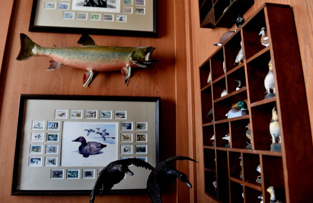A corner of Bud Grant's office features outdoors memorabilia at the new Twin Cities Orthopedics Performance Center in Eagan on Friday, March 9, 2018. (Jean Pieri / Pioneer Press)