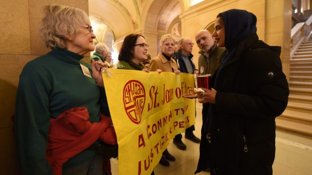 """Linda Muldoon, left, and Mary Jo Malecha and other members of the religious-activist group ISAIAH speak with Naheed Murad of the Muslim American Society of Minnesota during """"Muslim Day"""" in the rotunda of the State Capitol in St. Paul Tuesday, March 20, 2018. The two groups have formed a partnership to push legislation. Here, Murad was thanking the ISAIAH members for coming. (Dave Orrick / Pioneer Press)"""