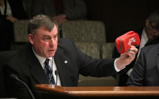 Lt. Jeff Kazel, commander of the Lake Superior drug task force, holds a kit containing naloxone, an opioid antidote used to reverse overdoses, as he testifies in favor of an opioid stewardship bill at the State Capitol on Thursday, March 1, 2018. The proposed legislation would charge a surcharge on opioid prescriptions to fund treatment and prevention programs. (Christopher Magan / Pioneer Press)