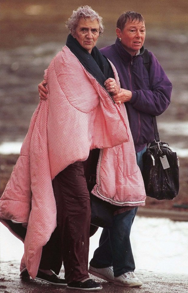 St. Peter, Minn. residents Mary Ann Lurth, left, and Susan Gray hold each other Sunday morning, March 29, 1998, after a tornado tore through the south-central Minnesota town. (AP Photo/Mankato Free Press, Greg Abbott)