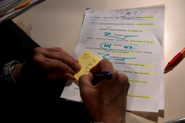 """""""Even the Russians can't break my writing code 'cuz I can't understand it either!"""" said Stan Turner as he takes notes in the studio before his """"All Request and Dedication Show"""" at KLBB-1220 radio station in downtown Stillwater on Thursday, March 15, 2018. (Jean Pieri / Pioneer Press)"""