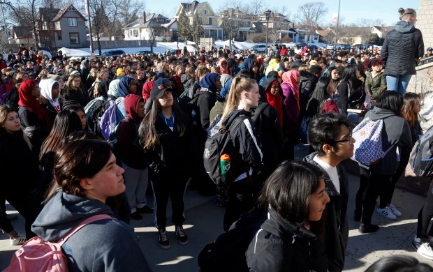 Central High School students stood quietly as names of the Parkland, Fla., shooting victims names were read Wednesday, March 14, 2018, in St. Paul, Minn. Students across the country participated in walkouts Wednesday to protest gun violence, one month after the deadly shooting inside a high school in Parkland, Fla. (AP Photo/Jim Mone)