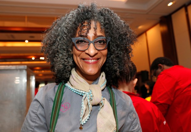 "American chef and television personality Carla Hall, known for her role on Bravo's ""Top Chef"" competition and ""The Chew,"" poses for a photograph while preparing tasting plates, Tuesday, Feb. 27, 2018, during the annual C-CAP (Careers through Culinary Arts Program) benefit in New York. (AP Photo/Kathy Willens)"