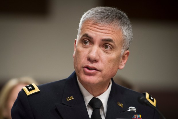 Army Lt. Gen. Paul Nakasone appears before the Senate Armed Services Committee to discuss his qualifications as nominee to be National Security Agency Director and U.S. Cyber Command Commander, during a hearing on Capitol Hill in Washington on Thursday, March 1, 2018. (AP Photo/Cliff Owen)