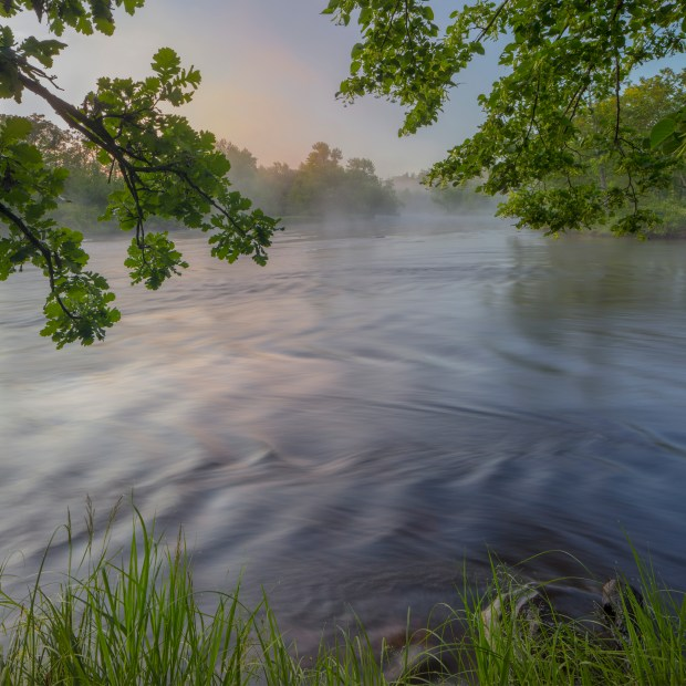 """""""Morning fog, St. Croix River downstream from Riverside Landing"""" is one of the photos from """"St. Croix and Namekagon Rivers: The Enduring Gift"""" by photographer Craig Blacklock. (Courtesy of Craig Blacklock)"""