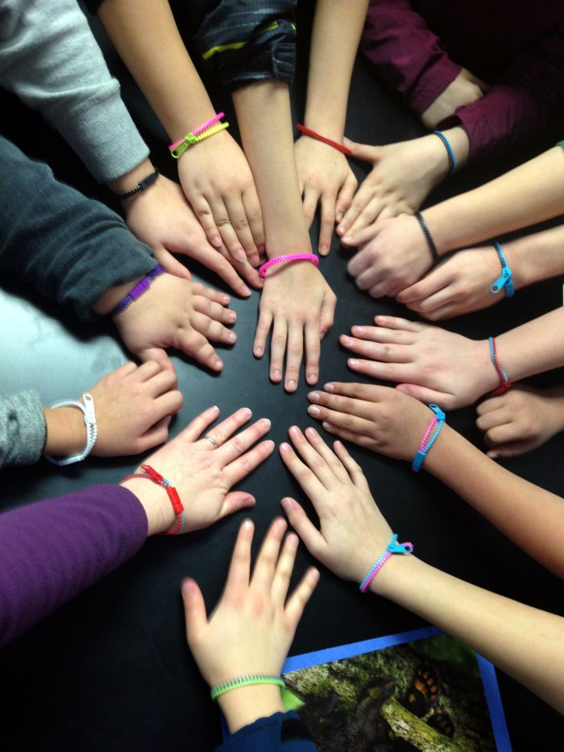 After Marshal Buck, 15, was critically injured in a car accident in December 2017, classmates at Open World Learning Community on St. Paul's West Side began wearing plastic bracelets as a sign of support. (Courtesy of Open World Learning Community)