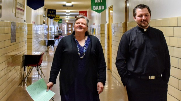 """Elizabeth """"Libby"""" Wegner, principal of Central Lutheran School and Pastor Nick Kooi talk about the future of the school as they walk through the halls Saturday, April 21, 2018. (Deanna Weniger / Pioneer Press)"""