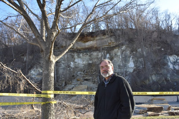 Bob Bejblik stands in front of a rock slide on Wabasha Street in St. Paul Saturday, April 28, 2018. He owns the house on top of the hill and said there was a rock slide below his property in February 2017. (Deanna Weniger / Pioneer Press)