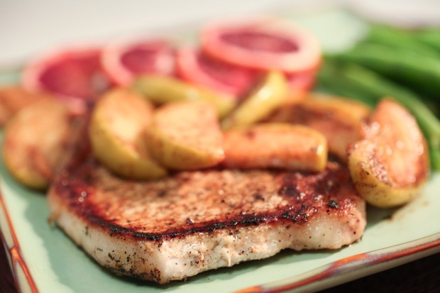 Cinnamon-Apple Pork Chop photographed in the St. Louis Post-Dispatch photo studio on Wednesday, March 21, 2018, in St. Louis, Mo. (Nikos Frazier/St. Louis Post-Dispatch/TNS)
