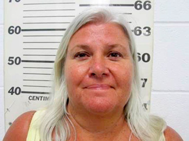 This photo provided by the South Padre Island Police Department shows Lois Riess, of Blooming Prairie, Minn., who was arrested by federal deputy marshals Thursday, April 19, 2018, at a restaurant in South Padre Island, Texas. Investigators believe she killed her husband in Minnesota then fled to Florida where she used the same gun to slay her doppelganger with the intention of assuming her identity. Riess had been on the run since at least late March. (South Padre Island Police Department via AP)
