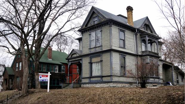 Developers are eyeing homes at 1911 Iglehart Ave. W., left, and 1905 Iglehart Ave. W., in St. Paul's Merriam Park neighborhood, seen on April 12, 2018, for three or even four new homes. The owners' family wants their elderly parents to be able to sell the two stately houses, which date to 1885 and 1900, respectively. The city is studying establishing a historic district in Merriam Park, but a temporary moratorium against lot splits and demolitions that would block the removal of both houses was voted down by the city council in April. (Lisa Legge / Pioneer Press)