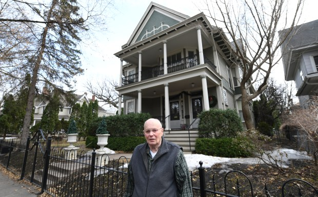 Ray Meyer stands in front of his Queen Anne Victoria home.
