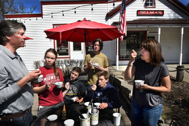 """Selma's Ice Cream owner Rebecca Nickerson, right, and her family, from left, husband Paul Nickerson, their children, Mya Anderson, Fletcher Anderson, Tate Nickerson and Kade Nickerson, taste test three different ice cream flavors at the Afton shop on Wednesday, April 25, 2018. From the three possible new Selma's flavors, they will choose one to honor Olympic gold medalist Jessie Diggins. Diggins, an Afton native and a graduate of Stillwater Area High School, won Team USA's first gold medal in Nordic skiing at the Olympics in Pyeongchang, South Korea. She will be honored during a city-wide celebration called """"Bringing Home the Gold"""" on May 12. The new ice cream will debut that day. (Jean Pieri / Pioneer Press)"""