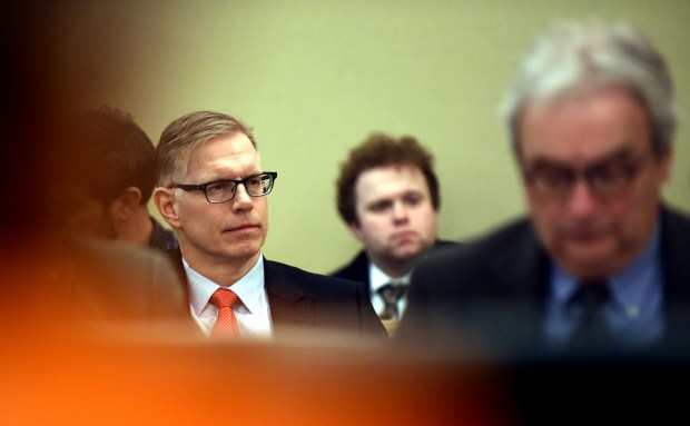 Paul Meekin, center, who was fired from Minnesota's information technology agency following the botched rollout of a new computer system known as MNLARS, watches a hearing at the Capitol Tuesday, April 10, 2018. Meekin briefly defended himself and then stood for questions. No lawmaker asked any. (Dave Orrick / Pioneer Press)