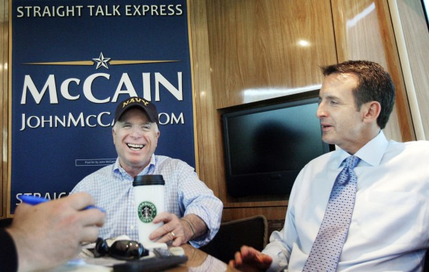 Republican presidential candidate Sen. John McCain, R-Ariz., left, has a laugh with Minnesota Gov. Tim Pawlenty as the two leaders ride in McCain's campaign bus in Minneapolis, Minn., Thursday, June 19, 2008. (LM Otero / Associated Press)
