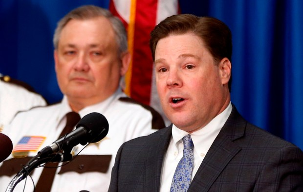 Carver County Attorney Mark Metz, right, announces at a press conference Thursday, April 19, 2018 in Chaska, Minn., that no criminal charges will be filed in the death of musician Prince in 2016. The decision effectively ends the state's two-year investigation into how Prince got the fentanyl that killed him. At left is Sheriff Jim Olson. (AP Photo/Jim Mone)