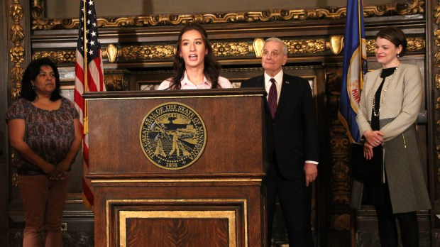 Maddie Harrah, an Apple Valley resident and University of Minnesota student, discusses her support of Gov. Mark Dayton's tax proposal Thursday, April 19, 2018 at the State Capitol in St. Paul. The governor's plan allows taxpayers to continue to deduct higher education expenses. (Christopher Magan / Pioneer Press)