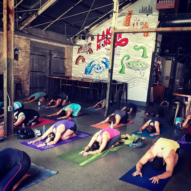 Take an hourlong yoga class, then enjoy a pint of Lake Monster Beer at the brewery's taproom in St. Paul. (Courtesy of Yoga and a Pint)