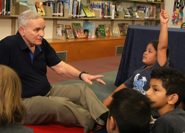 Gov. Mark Dayton talks with students at Bruce Vento Elementary Thursday, May 17, 2018 on St. Paul's Eastside before a rare public veto of a GOP-backed tax bill.