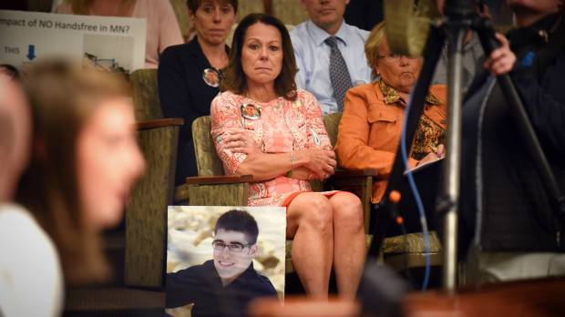 Kathy Kostohryz of Lake Elmo, whose nephew David Riggs, pictured, was killed in a distracted-driving crash in 2013, watches the family of another victim of a distracted-driving crash speak to lawmakers at the State Capitol in St. Paul Thursday, May 10, 2018. Families of victims took to the Capitol Thursday to press for a law requiring hands-free use of cell phones while driving. Speaking is Sylvie Tikalsky, whose grandfather Joe was killed by a texting driver while he was getting the mail in 2015. (Dave Orrick / Pioneer Press)