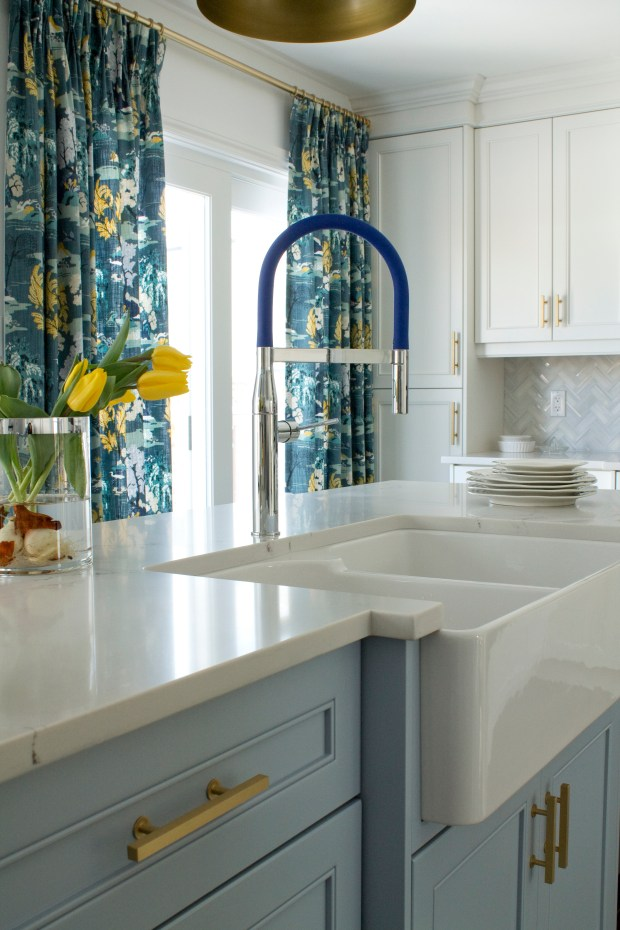 Designer Christine Elliott installed the Grohe Essence Semi-Pro single-handle faucet in this kitchen, with a blue hose that picks up the blue in the curtains. (Christine Elliott)