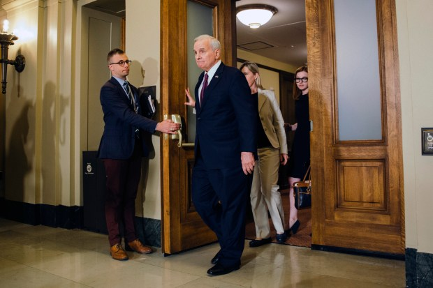 Gov. Mark Dayton leaves the Cabinet Room inside the Minnesota State Capitol after a meeting with Republican leadership in St. Paul, Minn. on Friday, May 18, 2018. With time winding down in the legislative session, Gov. Mark Dayton and Republican leaders were searching Friday for a compromise on a tax bill that averts a complex 2019 tax filing season and Dayton's push for additional school funding. (Evan Frost/Minnesota Public Radio via AP)