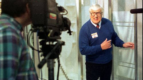 Menards spokesman Ray Szmanda, 72, of Antigo, Wis., films a television commercial for shower doors in this December, 1996 file photo taken at a Menards store in Eau Claire, Wis. Szmanda is retiring after 23 years as the company's pitchman. (AP Photo/Eau Claire Leader-Telegram, Steve Kinderman, File)