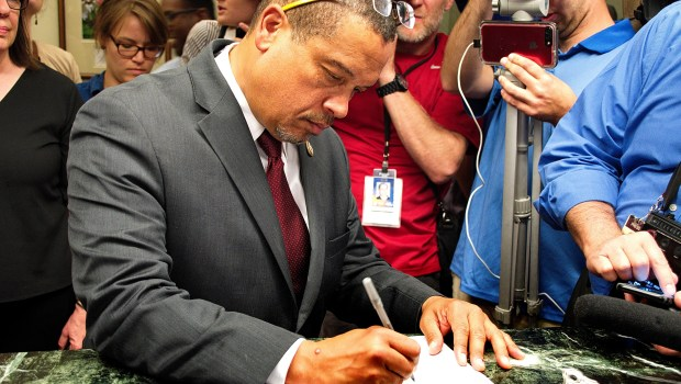 U.S. Rep. Keith Ellison signs paperwork to run for Minnesota attorney general on Tuesday, June 5, 2018 at the Secretary of State's office in St. Paul. He and others filed on the last day to become a candidate. (Don Davis / Forum News Service)