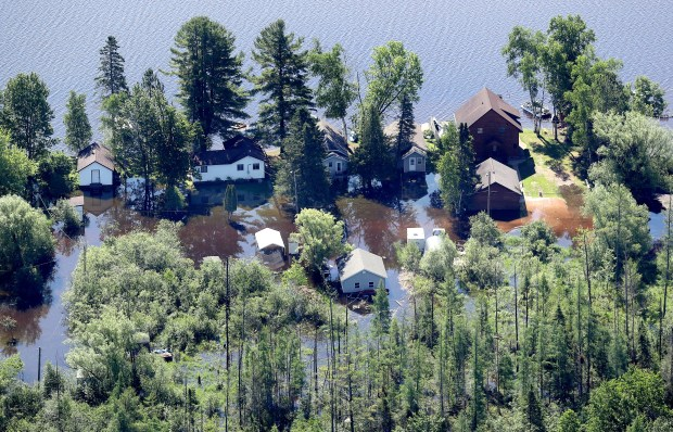 Homes along Amnicon Lake in Douglas County, Wis., are flooded by rising waters from the lake Monday morning, June 18, 2018. A man was found dead near his submerged pickup truck south of Ashland on Monday and a man from Minnesota died after a tree fell on his camper in Sawyer County on Sunday after storms caused extensive flooding and washed-out roads in northwestern Wisconsin this weekend. (Bob King / Forum News Service)
