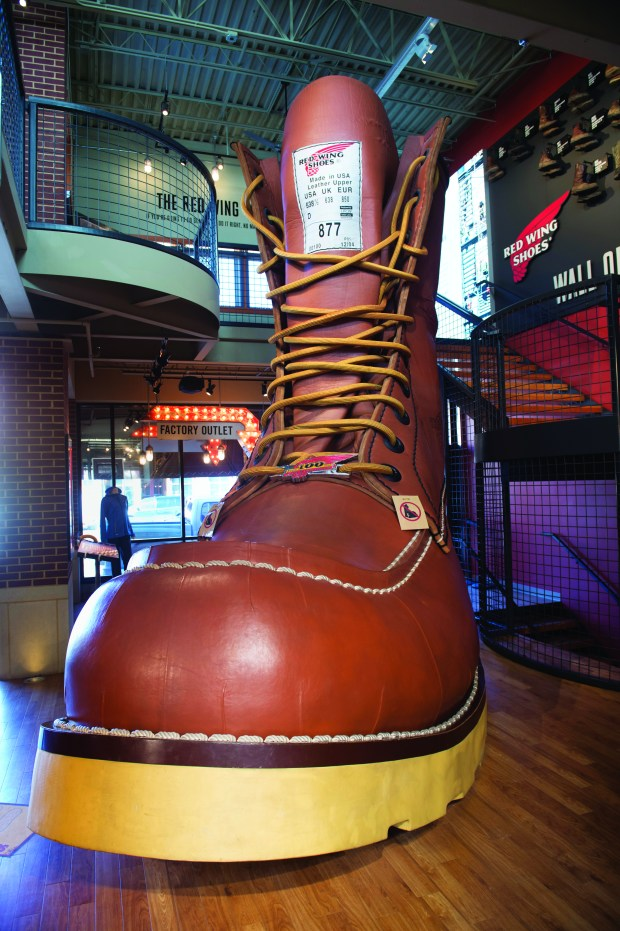The worlds largest boot, 20 feet long-16 feet high and 2300 pounds, as recorded the Gunness Book of World Records greets you as you enter the Red Wing Shoe store. The iconic brand started here, and features a store in the heart of downtown. The main floor is a retail store with a museum is upstairs and an outlet store is downstairs. Thursday, April 19, 2018. (Special to the Pioneer Press: Craig Lassig)