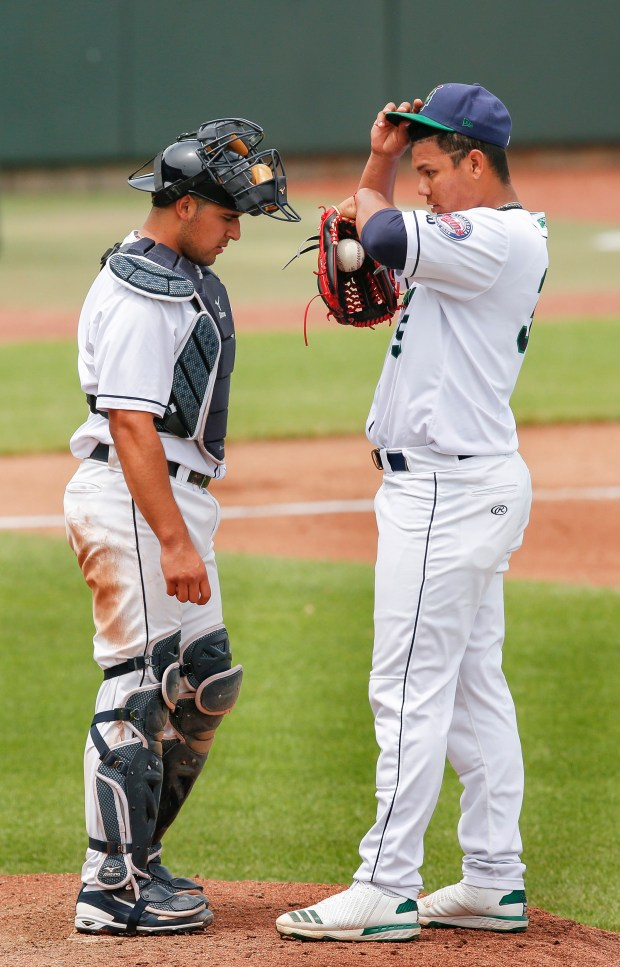 Cedar Rapids Kernels pitcher Brusdar Graterol (right) talks to catcher David Banuelos during the top of the sixth inning of their Midwest League baseball game against the Beloit Snappers at Veterans Memorial Stadium in southwest Cedar Rapids, Iowa, on Wednesday, June 6, 2018. (Jim SlosiarekThe Gazette)