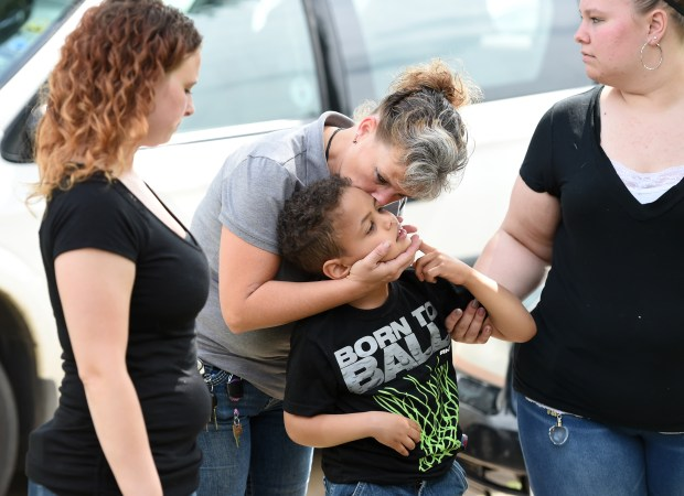 Cedarius Nanoff, 7, gets a kiss from his grandmother, Cindy Nanoff, as she arrives at his home in Hastings Wednesday, June 20, 2018. Her daughters, Ashley, left, and Stacie are around her. (Jean Pieri / Pioneer Press)