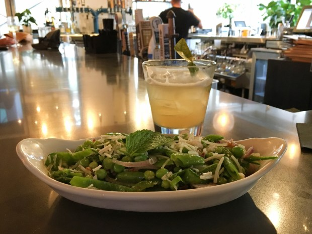 Pea and bacon salad and a cocktail at Gray Duck Tavern in downtown St.Paul. Shot in June 2018. (Jess Fleming / Pioneer Press)