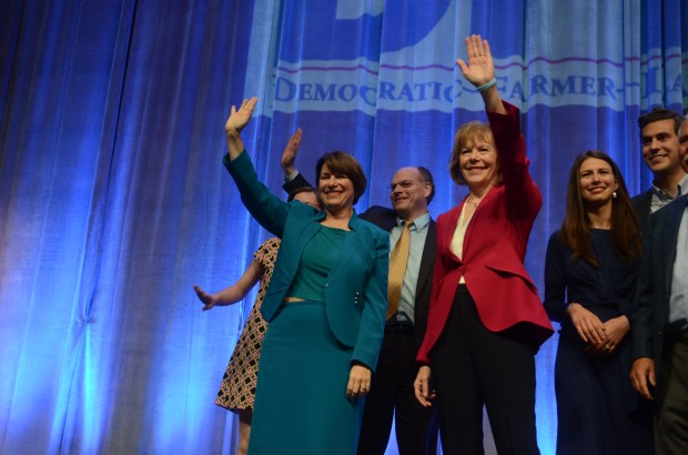 U.S. Sens. Amy Klobuchar and Tina Smith and their families wave to the crowd at the Democratic-Farmer-Labor Party convention Friday, June 1, at the Mayo Civic Center in Rochester. (Christopher Magan / Pioneer Press)