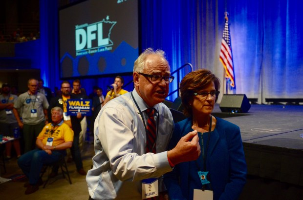 Congressman Tim Walz and state Auditor Rebecca Otto confer Saturday, June 2, on the convention floor at the Mayo Civic Center in Rochester. Walz and Otto were vying for the endorsement for governor with state Rep. Erin Murphy of St. Paul. (Christopher Magan / Pioneer Press)